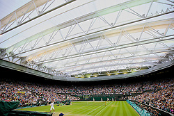LONDON, ENGLAND - Monday, June 30, 2014: Andy Murray (GBR) serves in the roof of centre court during the Gentlemen's Singles 4th Round match on day seven of the Wimbledon Lawn Tennis Championships at the All England Lawn Tennis and Croquet Club. (Pic by David Rawcliffe/Propaganda)