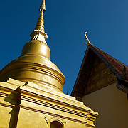 Stupa at Wat Phra Singh in Chiang Rai, Thailand...Wat Pra Singh is located on Thanon Singkhlai in Tambon Wiang, Mueang district, Chiang Rai Province, northern Thailand..Wat Pra Singh was built by Pra Chao Maha Proma (P.E. 1345 ? 1400), circa 1385 (B.E. 1928).