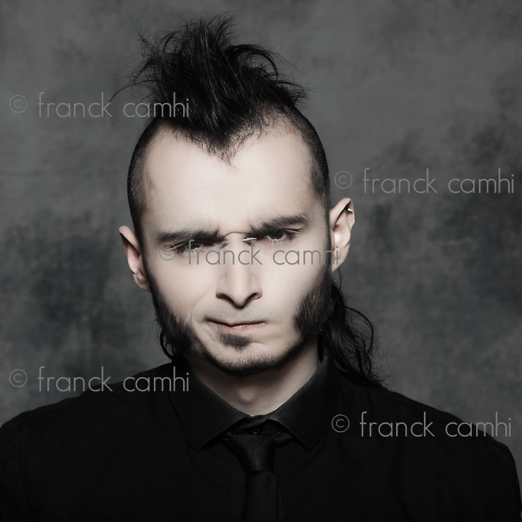 studio expressive portrait of a young punk man hansome on isolated background