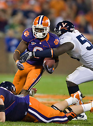 November 21, 2009; Clemson, SC, USA;  Clemson Tigers wide receiver Jacoby Ford (6) is tackled by Virginia Cavaliers linebacker Cam Johnson (56) during the fourth quarter at Memorial Stadium.  Clemson defeated Virginia 34-21.