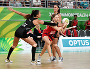 11th April 2018, Gold Coast Convention and Exhibition Centre, Gold Coast, Australia; Commonwealth Games day 7; Netball, England versus New Zealand; Jade Clarke of England catches a pass despite Maria Folau of New Zealand attempting to intercept