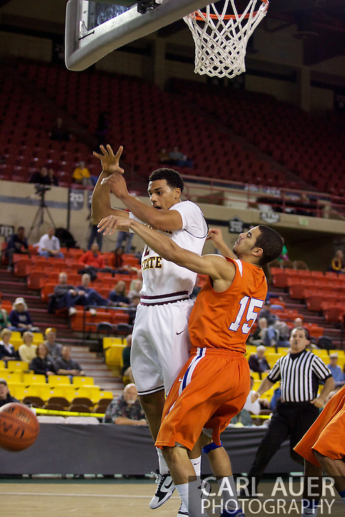 November 25th, 2010:  Anchorage, Alaska - Arizona States Trent Lockett (24) gets fouled hard by Houston Baptist guard Shawn Echols (15) in the Sun Devils 73-55 win over Houston Baptist in their first round game of the Great Alaska Shootout.