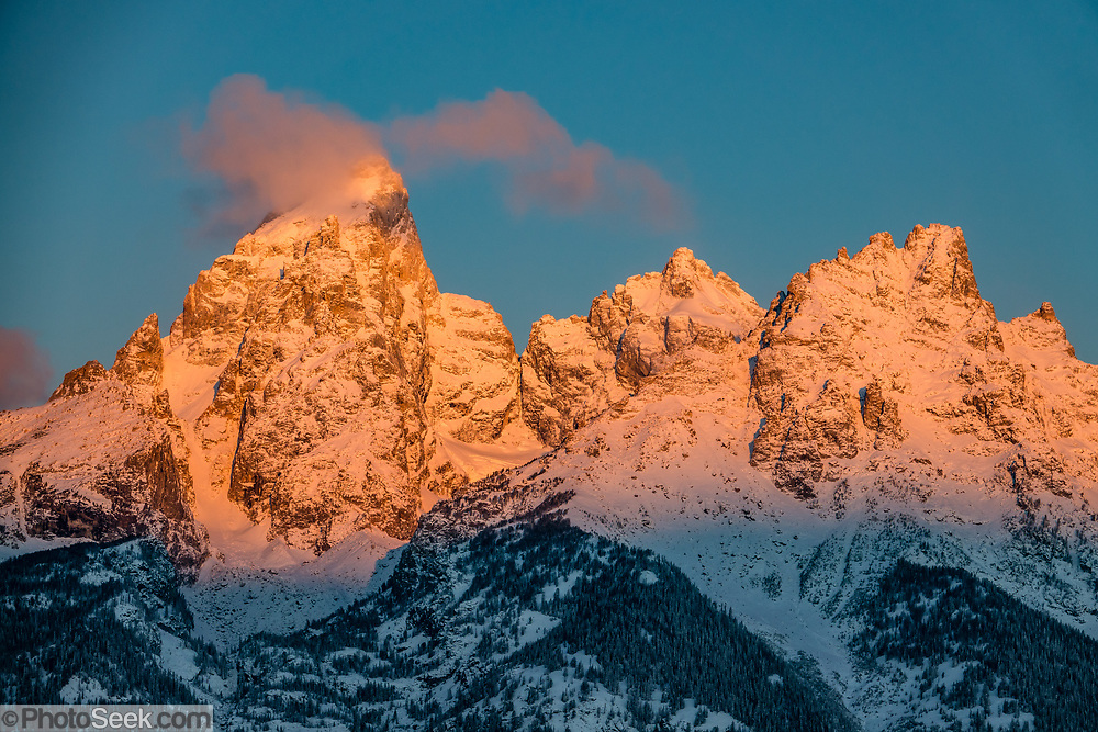 A golden sunrise illuminates Grand Teton, the highest mountain (13,775 feet) in Grand Teton National Park. Wyoming, USA.