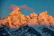 A golden sunrise illuminates Grand Teton, the highest mountain (13,775 feet) in Grand Teton National Park. Wyoming, USA.