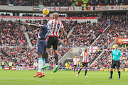 Sunderland defender Younes Kaboul competes with Newcastle United midfielder Moussa Sissoko for the header  during the Barclays Premier League match between Sunderland and Newcastle United at the Stadium Of Light, Sunderland, England on 25 October 2015. Photo by Simon Davies.