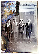 eroding glass plate with young adult decorated men