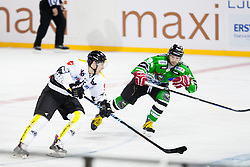 24.12.2014, Republic Square, Ljubljana, SLO, EBEL, HDD Telemach Olimpija Ljubljana vs EC Dornbirn, 30. Runde, in picture Chris D'Alvise (EC Dornbirn, #15) and Andrej Hebar (HDD Telemach Olimpija, #84) during the Erste Bank Icehockey League 30. Round between HDD Telemach Olimpija Ljubljana and EC Dornbirn on Republic Square, Ljubljana, Slovenia on 2014/12/16. Photo by Urban Urbanc / Sportida