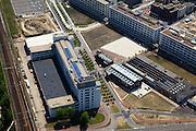 Nederland, Noord-Brabant, Eindhoven, 27-05-2013; Strijp-S, voormalige Philipsterrein, was niet toegankelijk voor het publiek, 'de verboden stad'. Het gebied, met diverse Rijksmonumenten, wordt ontwikkeld voor wonen, werken en cultuur.<br /> Philitefabriek met Klokgebouw (Strijp S), in het midden De Hoge (Witte) Rug. <br /> Strijp-S, former Philips area, was not accessible to the public, 'the forbidden city'. The area, with several national monuments, is designated for living, working and culture.<br /> Philitefabriek / Clock Building (Strijp S), in the middle the High (White) Back. <br /> <br /> luchtfoto (toeslag op standard tarieven);<br /> aerial photo (additional fee required);<br /> copyright foto/photo Siebe Swart