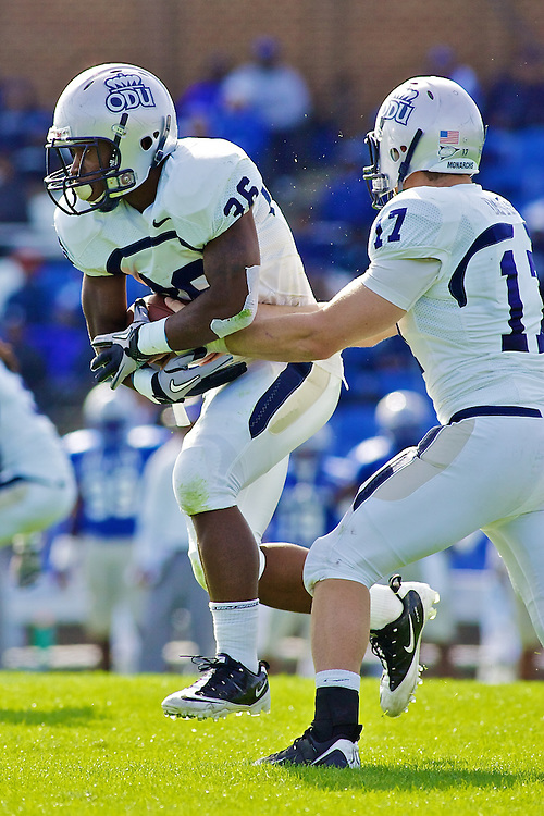 Oct 30, 2010; Hampton VA, USA; Old Dominion Monarchs quaterback Thomas DeMarco (17) hands the ball to running back Xavier Duckett (35) against the Hampton Pirates at Armstrong Stadium. The Monarachs won 28-14. Mandatory Credit: Peter J. Casey