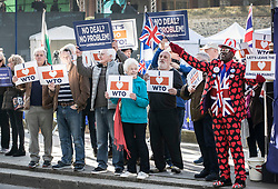 © Licensed to London News Pictures. 14/02/2019. London, UK. People demonstrating in support of World Trade Organisation rules gather outside Parliament ahead of a Brexit vote in the House of Commons later today. Photo credit: Peter Macdiarmid/LNP