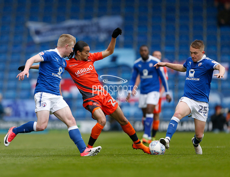 Chesterfield's Louis Reed(25) and Wycombe Wanderers Jack Williams(24) contest a loose ball during the EFL Sky Bet League 2 match between Chesterfield and Wycombe Wanderers at the b2net stadium, Chesterfield, England on 28 April 2018. Picture by Paul Thompson.