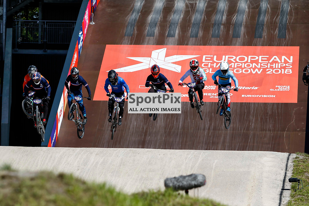 Riders leave the 8m starting gate during the heats of the BMX European Championships in Glasgow