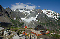 Hiker admiring view of Mount Shuksan from backcountry camp, Mount Basker Wilderness North Cascades Washington