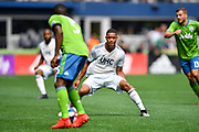 Brandon Bye #15 of New England Revolution reads Nouhou Tolo #5 of Seattle Sounders moves during a MLS soccer match on Saturday, Aug. 10, 2019, in Seattle. The teams played tp a 3-3 tie. (Alika Jenner/Image of Sport)
