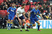AFC Wimbledon defender Jon Meades (3) battles for possession with Jan Vertonghen of Tottenham Hotspur (5) during the The FA Cup 3rd round match between Tottenham Hotspur and AFC Wimbledon at Wembley Stadium, London, England on 7 January 2018. Photo by Matthew Redman.