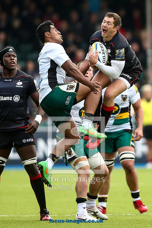 Alex Goode of Saracens (right) beats Ahsee Tuala of Northampton Saints (left) to a high ball during the Aviva Premiership match at Allianz Park, London<br /> Picture by Andy Kearns/Focus Images Ltd 0781 864 4264<br /> 17/09/2016