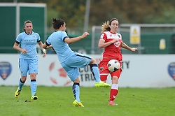 Bristol Academy Womens' Corinne Yorston chased down the ball to put Manchester City Womens' Nicola Harding under pressure - Photo mandatory by-line: Dougie Allward/JMP - Mobile: 07966 386802 - 28/09/2014 - SPORT - Women's Football - Bristol - SGS Wise Campus - Bristol Academy Women's v Manchester City Women's - Women's Super League