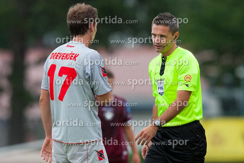 Drevensek Marko of Aluminij & fifa referee Damir Skomina during football match between NK Triglav Kranj and Aluminij, 2nd Round of Prva Liga, on 22 July, 2012, in Sportni center, Kranj, Slovenia. (Photo by Grega Valancic / Sportida)