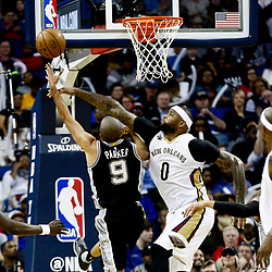 Mar 3, 2017; New Orleans, LA, USA; San Antonio Spurs guard Tony Parker (9) shoots over New Orleans Pelicans forward DeMarcus Cousins (0) during the second quarter of a game at the Smoothie King Center. Mandatory Credit: Derick E. Hingle-USA TODAY Sports