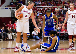 December 15, 2009; Stanford, CA, USA;  Duke Blue Devils forward Joy Cheek (21) is knocked to the ground after fouling Stanford Cardinal forward/center Jayne Appel (2) during the second half at Maples Pavilion.  Stanford defeated Duke 71-55.