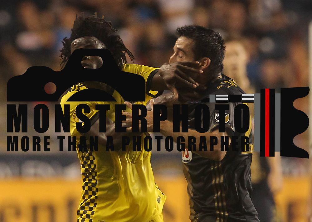 Philadelphia Union Midfielder ILSON PEREIRA DIAS (25)  battles Columbus Crew SC Defender LALAS ABUBAKAR (17) for the ball in the second half of a Major League Soccer match between the Philadelphia Union and Columbus Crew SC Wednesday, July. 26, 2017, at Talen Energy Stadium in Chester, PA.