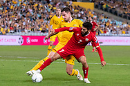 SYDNEY, AUSTRALIA - NOVEMBER 20: Australian forward Matthew Leckie (7) and Lebanon player Hassan Maatouk (7) fight for the ball at the international soccer match between Australia and Lebanon at ANZ Stadium in NSW, Australia. on November 20, 2018. (Photo by Speed Media/Icon Sportswire)