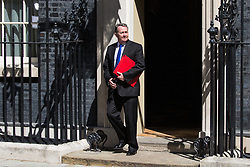 London, UK. 23 July, 2019. Liam Fox MP, Secretary of State for International Trade and President of the Board of Trade, leaves 10 Downing Street following the final Cabinet meeting of Theresa May's Premiership. The name of the new Conservative Party Leader, and so the new Prime Minister, is to be announced at a special event afterwards.