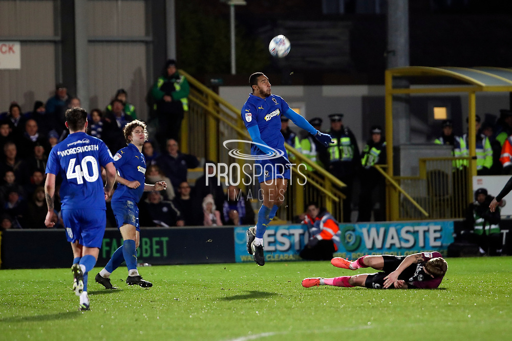 AFC Wimbledon defender Terell Thomas (6) winning header against Peterborough United attacker Sammie Szmodics (9) during the EFL Sky Bet League 1 match between AFC Wimbledon and Peterborough United at the Cherry Red Records Stadium, Kingston, England on 18 January 2020.
