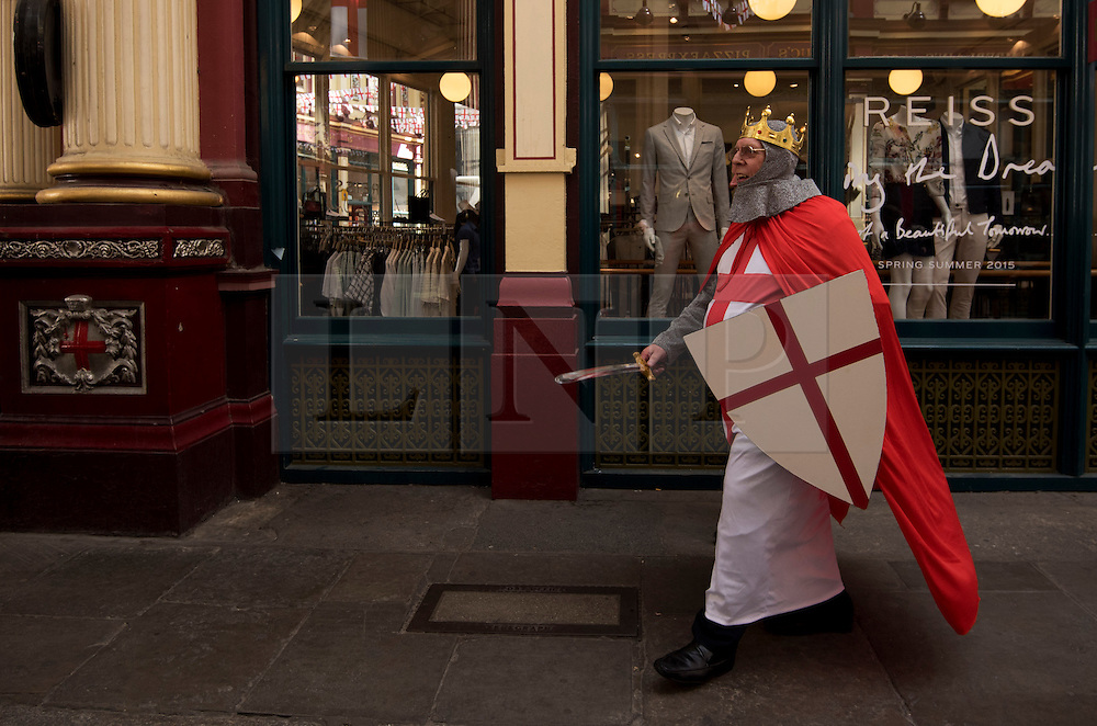 © Licensed to London News Pictures. 23/04/2015. <br /> LONDON, UK. Londoners celebrate Saint George's Day today in Leadenhall market with performances from morris dancers. The market is decorated with flags and bunting for the occasion. London, Thursday 23 April 2015. Photo credit : Hannah McKay/LNP