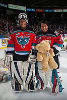 KELOWNA, CANADA - DECEMBER 2: Goalies Roman Basran #30 and James Porter #1 of the Kelowna Rockets pose on the ice during the annual teddy bear toss against the Kootenay Ice on December 2, 2017 at Prospera Place in Kelowna, British Columbia, Canada.  (Photo by Marissa Baecker/Shoot the Breeze)  *** Local Caption ***