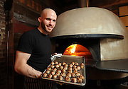 Chef Yair Lenchner with freshly made meatballs from the wood fired oven at Milkflower in Astoria, N.Y.