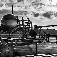 Passengers board a Jetstar Airways flight bound for Sydney at Hobart International Airport in Tasmania.