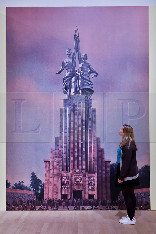 """© Licensed to London News Pictures. 07/11/2017. London, UK.  A student from Thomas Tallis School, Kidbrooke, south London, views """"1937"""", 1937, by Aleksandr Deineka at a preview of """"Red Star Over Russia: A Revolution in Visual Culture 1905-55"""" at Tate Modern.  The exhibition marks the centenary of the October Revolution and presents the visual history of Russia and the Soviet Union with works drawn from the late graphic designer David King. Photo credit: Stephen Chung/LNP"""