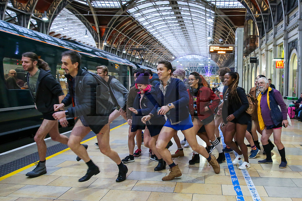 "© Licensed to London News Pictures. 13/01/2019. London, UK. Participants take part in 10th anniversary of 'No Trousers Tube Ride' by having fun and games at Paddington Station. The ""No Pants Subway Ride"" is an annual event staged by Improve Everywhere every January in New York City. The mission started as a small prank with seven guys and has grown into an international celebration of silliness, with dozens of cities including London around the world participating each year. Photo credit: Dinendra Haria/LNP"