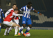 Brighton striker Elvis Manu shields the ball from Arsenal midfielder Ben Sheaf during the Barclays U21 Premier League match between Brighton U21 and Arsenal U21 at the American Express Community Stadium, Brighton and Hove, England on 30 November 2015. Photo by Bennett Dean.