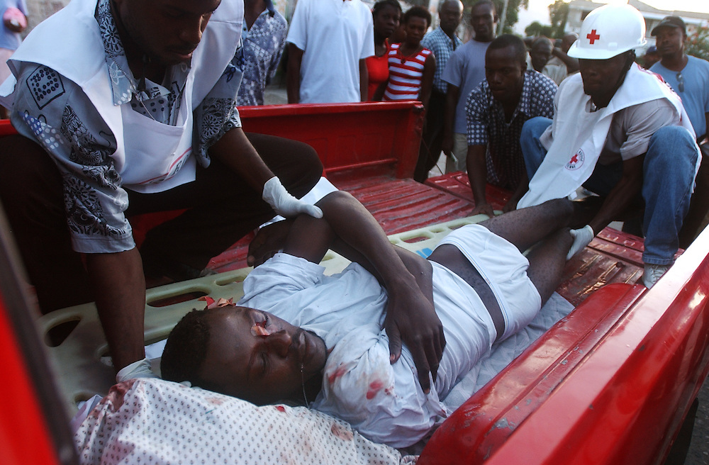A man who was shot through the face during a security operation carried out by the Haitian National Police and UN forces in Belair, one of the most dangerous neighborhoods in Port Au Prince, is transported by friends to the outskirts of the city where a Hatian Red Cross ambulance is waiting for him.   It is often difficult to transport the wounded to area hospitals as Red Cross ambulances refuse to enter some neighborhoods and family members are afraid that any gun shot victim will be taken from the hospital and put in jail. The security situation in Haiti has deteriorated in recent months with many Hatians and human rights groups accusing the Haitian National Police and various gangs of human rights violations.