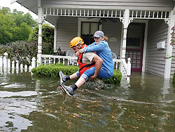 August 27, 2017 - Houston, TX, United States - National guardsmen rescue stranded residents after massive flooding from record rains overwhelmed roads and buildings throughout the city after Hurricane Harvey hit the Texas coast August 27, 2016 in Houston, Texas. (Credit Image: © Zachary West/Planet Pix via ZUMA Wire)
