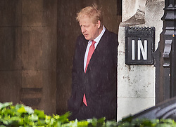 © Licensed to London News Pictures. 19/06/2019. London, UK. Conservative Party leadership candidate Boris Johnson passes an 'IN' sign at Parliament after casting his vote. Boris Johnson has cemented his position as favourite to become the next Prime Minister after winning a clear majority in the second round of the conservative party's leadership race. Photo credit: Peter Macdiarmid/LNP