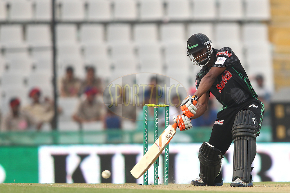 Khayelihle Zondo of the Dolphins square drives a delivery during match 4 of the Oppo Champions League Twenty20 between the Dolphins and the Perth Scorchers held at the Punjab Cricket Association Stadium, Mohali, India on the 20th September 2014<br /> <br /> Photo by:  Shaun Roy / Sportzpics/ CLT20<br /> <br /> <br /> Image use is subject to the terms and conditions as laid out by the BCCI/ CLT20.  The terms and conditions can be downloaded here:<br /> <br /> http://sportzpics.photoshelter.com/gallery/CLT20-Image-Terms-and-Conditions-2014/G0000IfNJn535VPU/C0000QhhKadWcjYs