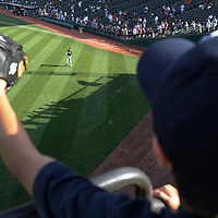 CLEVELAND, OH USA - JULY 6: A young fan shouts to New York Yankees pitcher Hector Noesi before the game between the Cleveland Indians and the New York Yankees at Progressive Field in Cleveland, OH, USA on Wednesday, July 6, 2011.