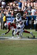 Los Angeles Rams defensive back Sam Shields (37) breaks away from a tackle attempt by Arizona Cardinals wide receiver Chad Williams (10) as he leaps and intercepts a fourth quarter pass and runs it back 22 yards to the Arizona Cardinals 25 yard line during the 2018 NFL regular season week 2 football game against the Arizona Cardinals on Sunday, Sept. 16, 2018 in Los Angeles. The Rams won the game in a 34-0 shutout. (©Paul Anthony Spinelli)