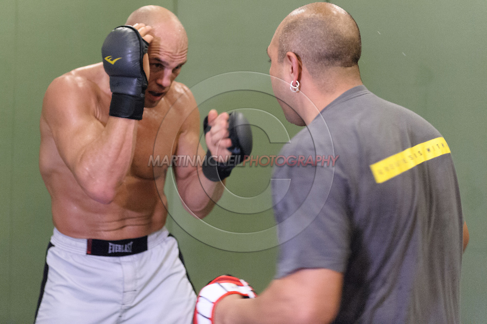 Randy Couture (facing) and Gil Martinez work on boxing drills during a training session ahead of UFC 105 at Straight Blast Gym in Manchester, England on November 11, 2009.