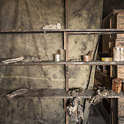 Shelf in Discovery Hut with misc food tins