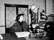 Joan Denise Moriarty, founder of professional ballet in Ireland, receives an Honorary Degree from University College Cork, at Iveagh House. Dr T.K. Whitaker, Chancellor of the National University of Ireland, holds the pen with which she signed the acceptance scroll.<br />