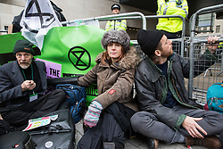 London, UK. 21st December, 2018. Environmental campaigners from Extinction Rebellion glued to railings outside Broadcasting House in protest against the lack of coverage by the BBC of the climate change crisis.