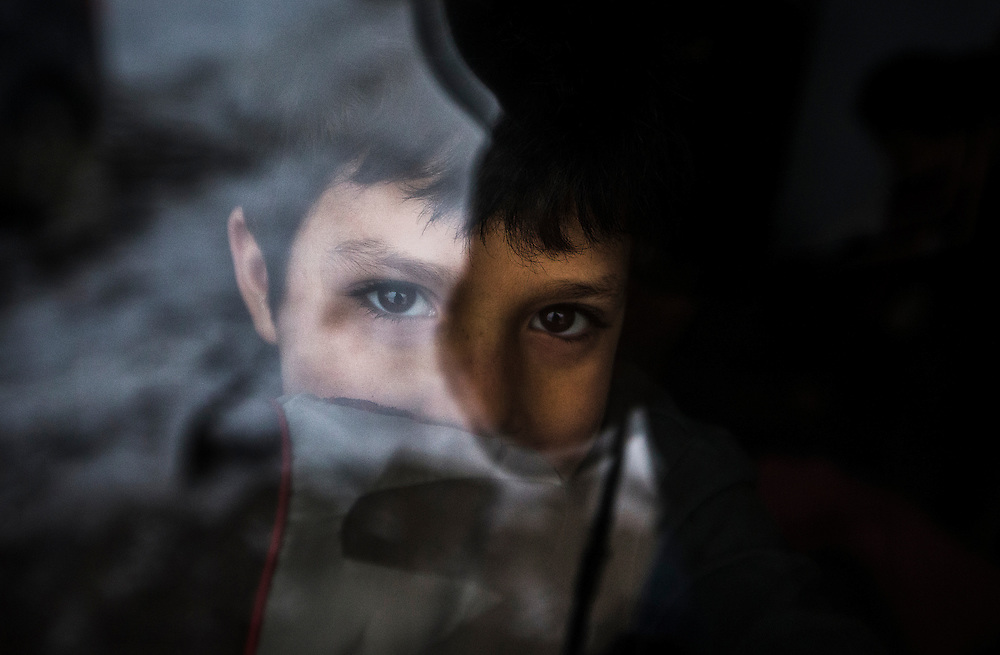 Syrian refugee Madjid Al Jasem looks outside the window from inside their temporary home in Picton, Ontario, Canada, Wednesday January 20, 2016.   (Mark Blinch for the BBC)