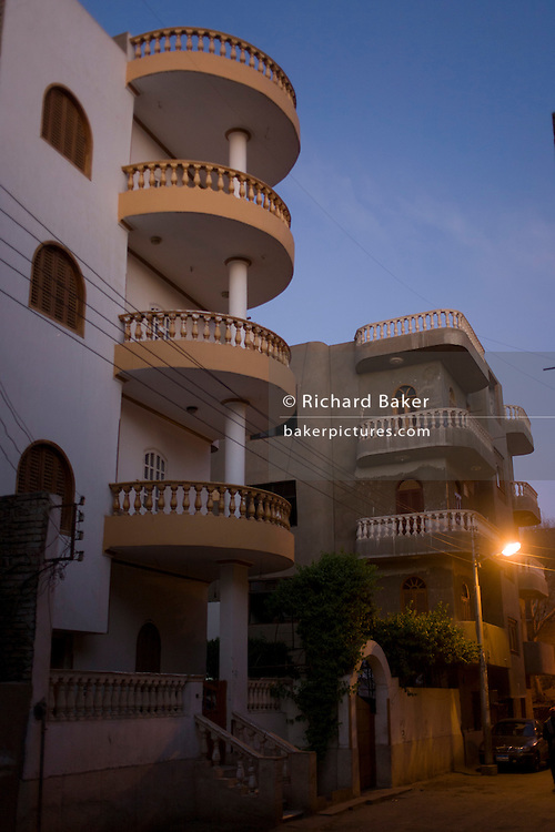 Middle-class housing at dawn in the village of Gezirat on the West Bank of Luxor, Nile Valley, Egypt.