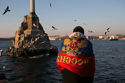Pro-russian crimean wearing a Russian Federation flag  in the waterfront of Sevastopol three days before the referendum. Ukraine , Thursday, 13th March 2014. Picture by Daniel Leal-Olivas / i-Images