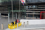 Workmen make repairs outside the Park Plaza at the southern end of Westminster Bridge in Southwark, on 26th March 2019, in London, England