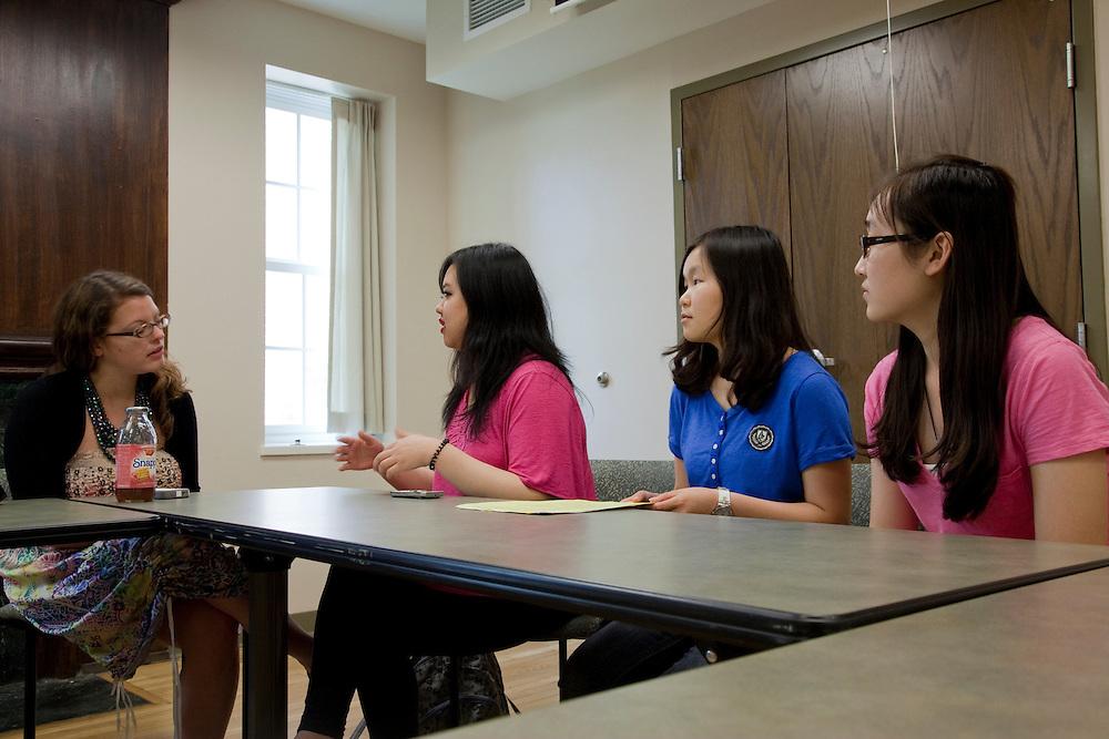 Kara Kauffman talks to Yang Wang, Shuwen Jiang, and Yinjiao Gong during a walk in advising session at the Walter International Education Center